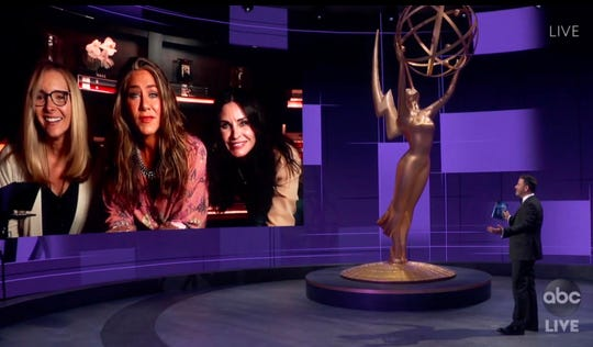 Jimmy Kimmel speaks with Lisa Kudrow, left, Jennifer Aniston and Courteney Cox during the 72nd Emmy Awards broadcast.