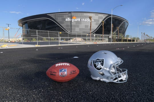 "General overall aerial view of Las Vegas Raiders helmet and Wilson 2020 NFL ""The Duke"" official football at the Allegiant Stadium construction site."
