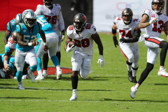 The Buccaneers' Leonard Fournette rumbles for a game-clinching 46-yard touchdown in a Week 2 victory over the Panthers.