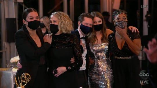 'Schitt's Creek' cast members accept the award for outstanding comedy series Sunday.