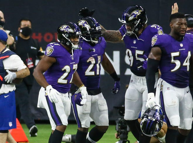 Baltimore Ravens running back Mark Ingram (21) celebrates with teammates after scoring a touchdown during the fourth quarter against the Houston Texans at NRG Stadium.