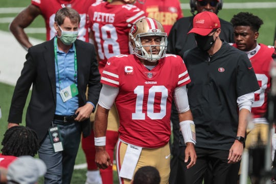 San Francisco 49ers quarterback Jimmy Garoppolo reacts while walking on the sidelines after injuring his ankle at MetLife Stadium on Sunday.
