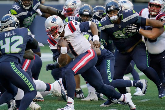 New England Patriots quarterback Cam Newton (1) rushes for a touchdown against the Seattle Seahawks during the first half of an NFL football game, Sunday, Sept. 20, 2020, in Seattle.
