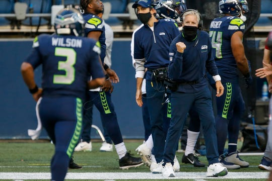 Seattle Seahawks head coach Pete Carroll reacts following a touchdown against the New England Patriots during the second quarter at CenturyLink Field.