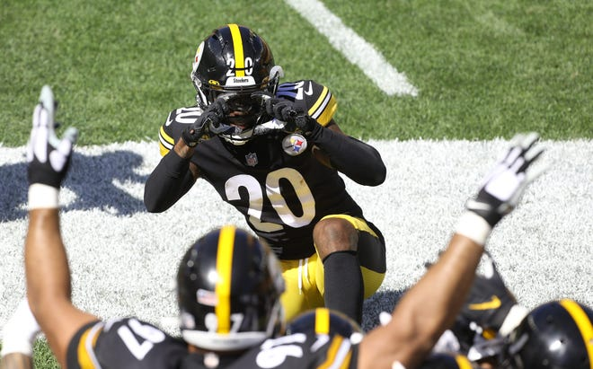 Week 2: Pittsburgh Steelers cornerback Cameron Sutton (20) pretends to take a photograph of his defensive teammates during the second quarter against the Denver Broncos.
