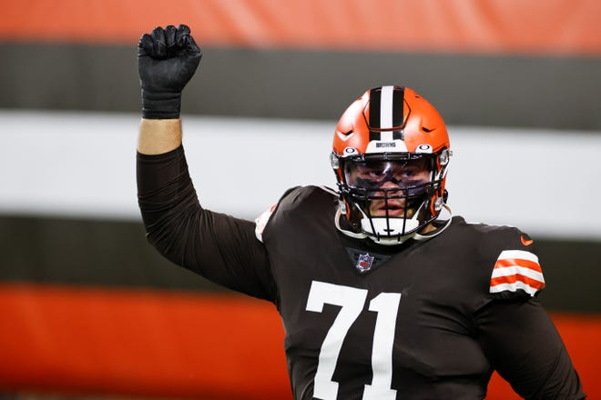 Browns offensive tackle Jedrick Wills (71) and wide receiver Rashard Higgins were cited for drag racing in Westlake on Tuesday. [Ron Schwane/Associated Press]