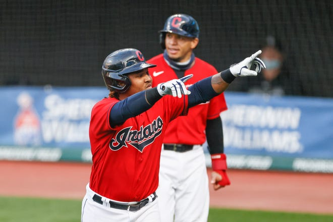 Cleveland Indians' Jose Ramirez celebrates with Cesar Hernandez after hitting a three run home run off Chicago White Sox starting pitcher Dane Dunning during the first inning of a baseball game, Monday, Sept. 21, 2020, in Cleveland. (AP Photo/Ron Schwane)