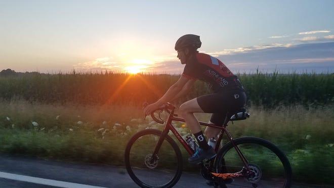 Ashland Bike Company employee Quinn Watson on a training ride in northern Ashland County's rolling gravel roads.