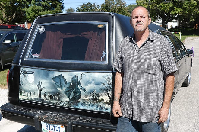 """Kenny Boykin drove three hours from New Castle, Indiana with his wife and teen daughter in their hearse to be in the hearse and hot rod show recently in Perrysville.  On their way , they had mechanical issues and had to tow it to the car show, with a semi truck strap they bought at a truck stop.""""We travel all over to these hearse shows,"""" Boykin said."""