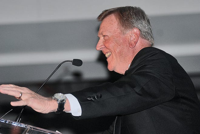 Joe Holladay enjoys a happy memory during his induction speech in 2014 for the Bartlesville Athletic Hall of Fame. Holladay progressed from being a local high school basketball coach to  being an assistant coach for Roy Williams for 20 years at Kansas and North Carolina. He was on the Tar Heels staff during the national championship seasons of 2005 and 2009.