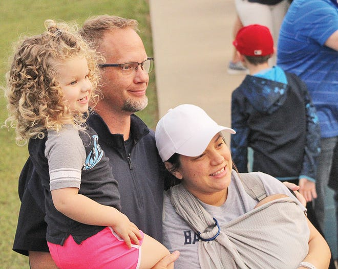 Bartlesville High head football coach Jason Sport poses prior to last week's game with his new son Gabriel (right), wife Ruth and daughter Chloe.