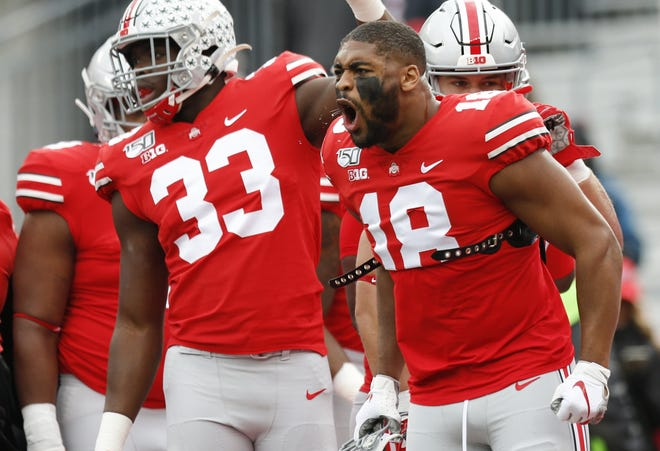 Ohio State defensive end Jonathon Cooper (18) gets fired up during warmups before a game against Penn State on Nov. 23, 2019, at Ohio Stadium. The Buckeyes won 28-17. [Joshua A. Bickel/Dispatch]