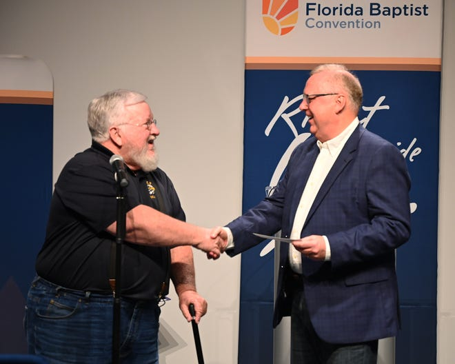 """BCF President Thomas A. Kinchen presents Dr. Tommy Green, Executive Director-Treasurer of the Florida Baptist Convention, a """"tithe"""" check for $35,000 from the $350,000 down payment for the sale of the Blue Springs Conference Center."""