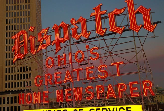 The orange neon Columbus Dispatch sign looms over Downtown.