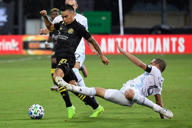 Crew midfielder Lucas Zelarayan tries to elude Minnesota United midfielder Osvaldo Alonso during a game Columbus lost in a shootout at the MLS is Back tournament in July. [Douglas DeFelice/USA TODAY]