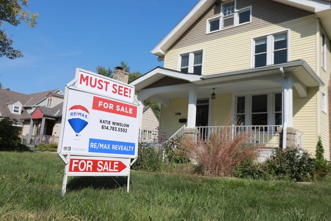A For Sale real estate sign was posted in front of a Clintonville home on Tuesday morning.