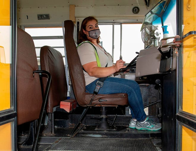 Lafourche Parish school bus driver Katrina Billiot prepares to head out to take kids home from school Tuesday afternoon.