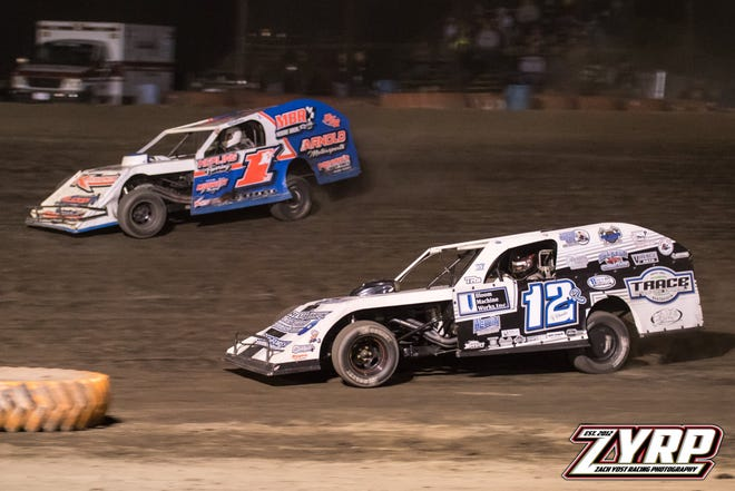 Kyle Moore and Ty Rhodes battle for the lead during the Bugs-R-Gone modified feature.