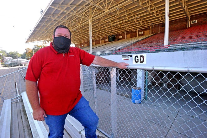 Matt Martin stands in front of the Grandstand which sat empty during the week of the Wayne County Fair after all Grandstand entertainment was canceled due to the coronavirus pandemic.