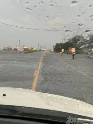 Lafourche Parish President Archie Chaisson posted this photo of flooding Monday on La. 1 south of the parish's hurricane-protection system.