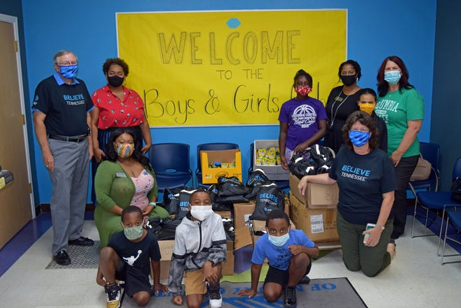 """Members of AT&T's """"Believe Tennessee"""" initiative pose with students from the Boys & Girls Clubs of Maury County."""