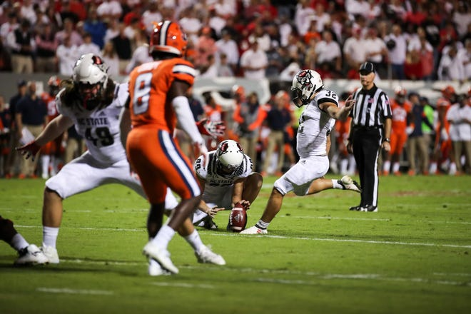 North Carolina State's Christopher Dunn kicks a 25-yard field goal against Syracuse during their 2018 game. Dunn opened his 2020 season by kicking a field goal and six extra points in the Wolfpack's 45-42 win over Wake Forest on Saturday.