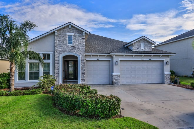 Just beyond the stylish, realistic-looking faux stone, clean colors and covered entryway of this Port Orange home is a modern and chic interior space, with four bedrooms, three bathrooms and a three-car garage.
