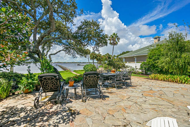 This  one-of-a-kind Daytona Beach estate is made every more desirable by this slate terrace and the paver walkway that leads to a 400-foot dock, with two deep-water boat lifts.