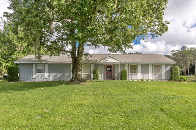 Horse lovers will love this quaint ranch home, nestled on nearly four-and-a-half acres that have been cleared and fenced in Port Orange.