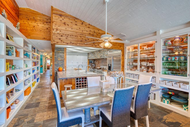 This remarkable oceanfront home in Ponce Inlet has been fortified and upgraded, with an interior that features vaulted cedar-plank ceilings, built-in shelving, plantation shutters and tongue-and-groove pine.