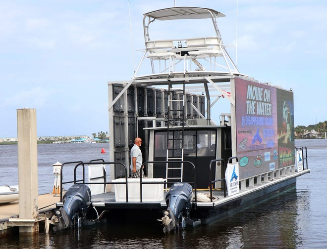 """The Shark Bite Media 60-foot barge, outfitted with two giant 40-foot LED billboards and over 2.5 million LED lights, Tuesday Sept. 22, 2020 at the Sea Love Marina in Ponce Inlet. The craft is typically used for advertising but will play """"Back to the Future"""" for a movie night on Disappearing Island on Sept. 26."""