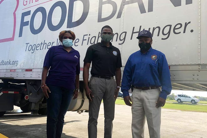 Greater Baton Rouge Food Bank Board Member Tamiko Francis Garrison, District 58 State Representative Ken Brass, and Donaldsonville Mayor Leroy Sullivan were among the supporters of the Sept. 17 food distribution in Donaldsonville.