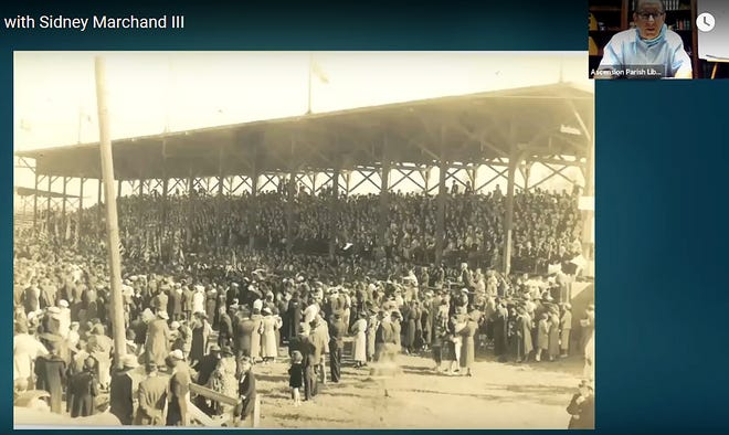 During an Ascension Parish Library video presentation, Sidney Marchand III discusses a historic photo of the crowd attending the Louisiana State Fair in Donaldsonville.