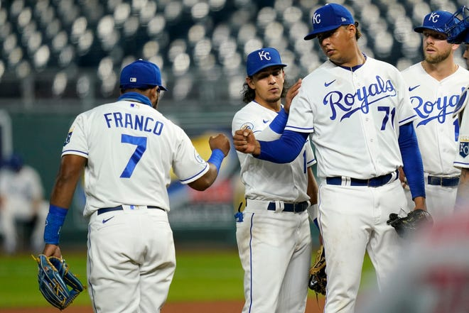 Kansas City Royals starting pitcher Carlos Hernandez (71) fist-bumps third baseman Maikel Franco (7) before leaving in the fourth inning of Monday's game against the St. Louis Cardinals at Kauffman Stadium. Franco provided the winning run with a two-out go-ahead single in the sixth inning as the Royals prevailed 4-1.