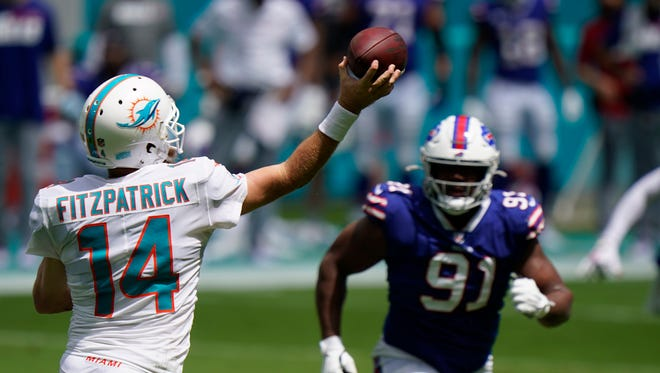 Miami Dolphins quarterback Ryan Fitzpatrick (14) looks to pass as Buffalo Bills defensive tackle Ed Oliver (91) is down field, during the first half of an NFL football game, Sunday, Sept. 20, 2020 in Miami Gardens, Fla.