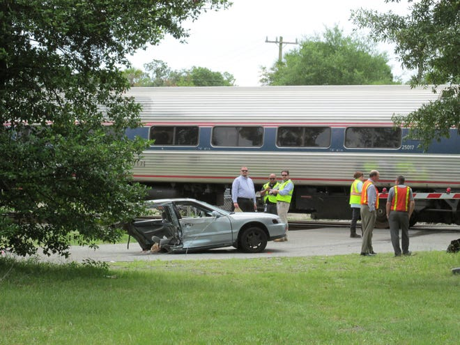 This Honda was cut in half on June 2, 2015, by an Amtrak train after it went through the railroad crossing on Willow Branch Avenue. All three in the car were injured, police said.