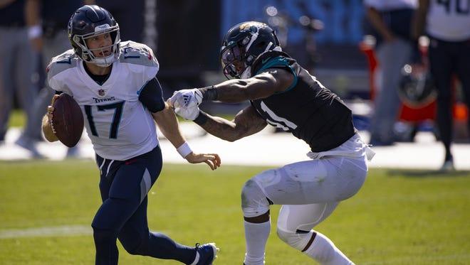 Jaguars defensive end Josh Allen pressures Tennessee quarterback Ryan Tannehill on Sept. 20 in Nashville, Tenn.