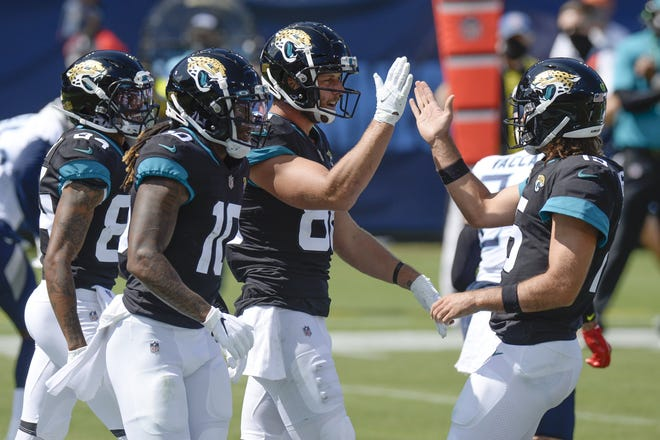 Jaguars tight end Tyler Eifert is congratulated by quarterback Gardner Minshew (right) after teaming up for a 19-yard touchdown pass against the Tennessee Titans on Sunday.