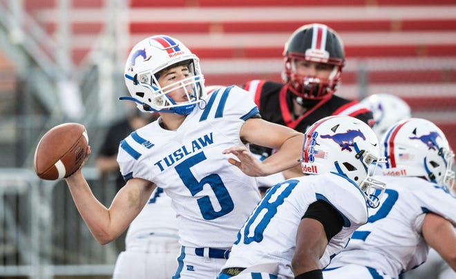 Tuslaw quarterback Troy Harbeitner delivers a pass during the Mustangs' Week 2 loss.
