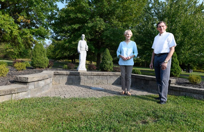 Tom and Chiquita Seesan talk about recent upgrades made to St. Joseph Cemetery at 2498 Erie St. S in Massillon. An anonymous donor provided funding to replace the landscaping near the near the cemetery chapel as well as install a fence along the perimeter and an electronic gate. (IndeOnline.com / Kevin Whitllock)
