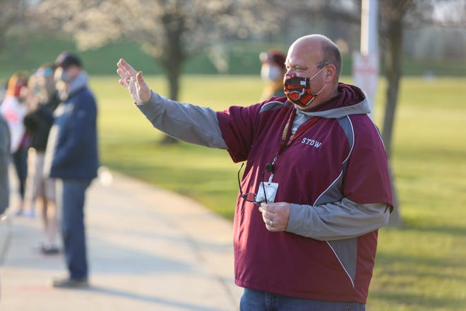 Stow-Munroe Falls CIty School District Superintendent Tom Bratten waves to the seniors of the 2020 class in a parade at the high school in April. Bratten said the district will remain in a hybrid learning plan for the time being.