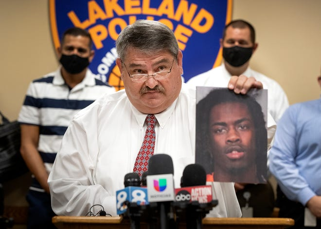 Lakeland Assistant Police Chief Sammy Taylor holds up a photo of Jacarie Dovontis Moore who was arrested on a charge of first-degree murder during a press conference at police headquarters Tuesday. Lakeland police announced the arrest in connection with the July 19 shooting death of Jeannairy Dominguez at her Monroe Street home.