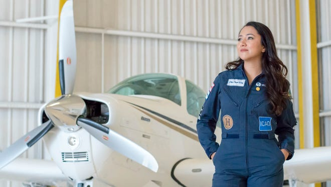 Shaesta Waiz at an airplane hangar in Daytona Beach,  where she returned after her flight around the world.