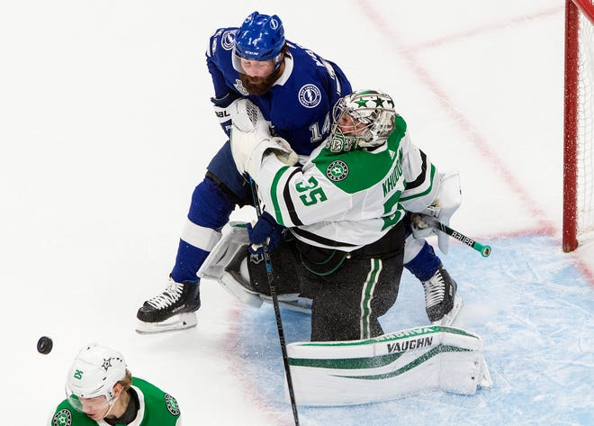 Dallas goalie Anton Khudobin (35) is crashed into by Tampa Bay's Pat Maroon (14) Monday during Game 2 of the Stanley Cup Finals.