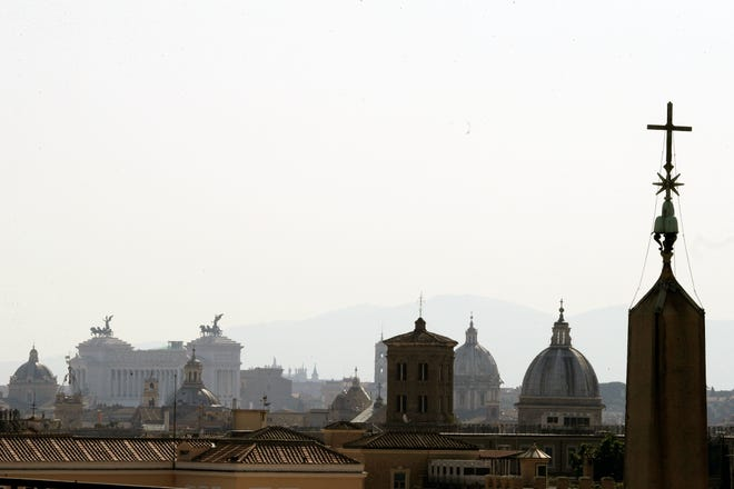 "Rome's skyline is seen from the St. Damaso balcony at the Vatican recently. The Vatican on Tuesday reaffirmed its stance that euthanasia and assisted suicide are ""intrinsically evil,"" and told priests they should minister to those contemplating such deaths to try to change their minds but shouldn't be present at the end if they don't."