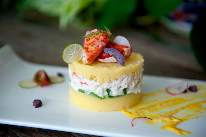 Lola and Dr. Augusto Lopez-Torres serve Peruvian Causa at their home in Palm Beach recently. Food styling by Giordano Marchese Lopez-Torres.