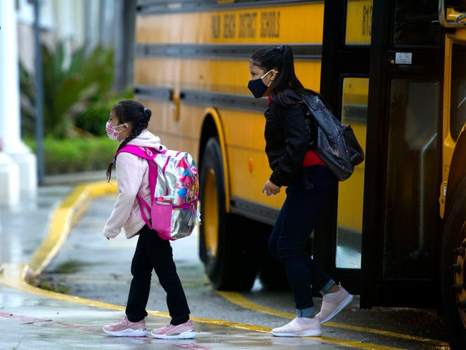 Students arrive for the first day of on-campus learning at Palm Beach Public Elementary School in September.