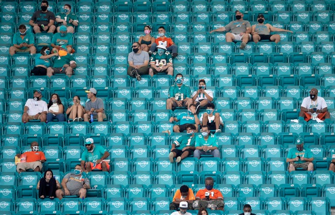 Fans practice social distancing while wearing masks during last Sunday's game at Hard Rock Stadium, and the scene will be similar Thursday night in Jacksonville.