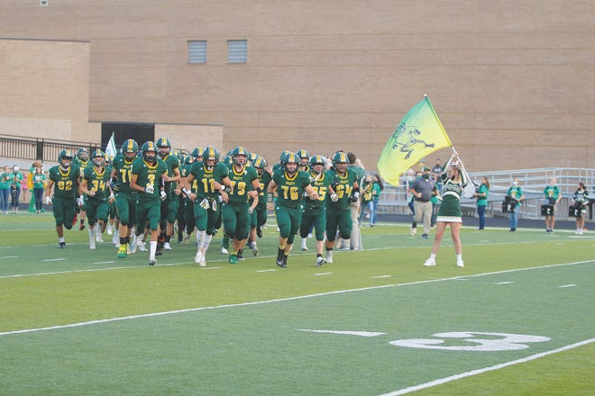 The Pratt High School football team rumbles onto Zerger Field on September 18, ready to take on the Hesston Swathers. The Greenbacks played tough all four quarters in a see-saw battle, but came out 15-24 at the final buzzer.