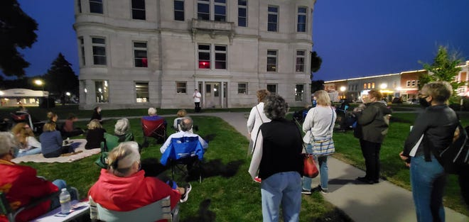 A crowd gathers around the courthouse in Adel on Monday, Sept. 21, 2020 for the vigil and memorial for the late Justice Ruth Bader Ginsburg.